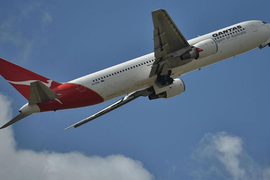 A Qantas plane takes off at Sydney Airport. Three of the airline's planes were forced to make unscheduled landings, including the turnaround of one of the world's longest haul flights. -- PHOTO: AFP