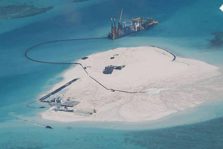 A photograph dated Feb 25, 2014 of the Johnson South Reef, which is claimed by the Philippines and Vietnam andappears to show large-scale reclamation in stages done by China. -- PHOTO:DEPARTMENT OF FOREIGN AFFAIRS, PHILIPPINES