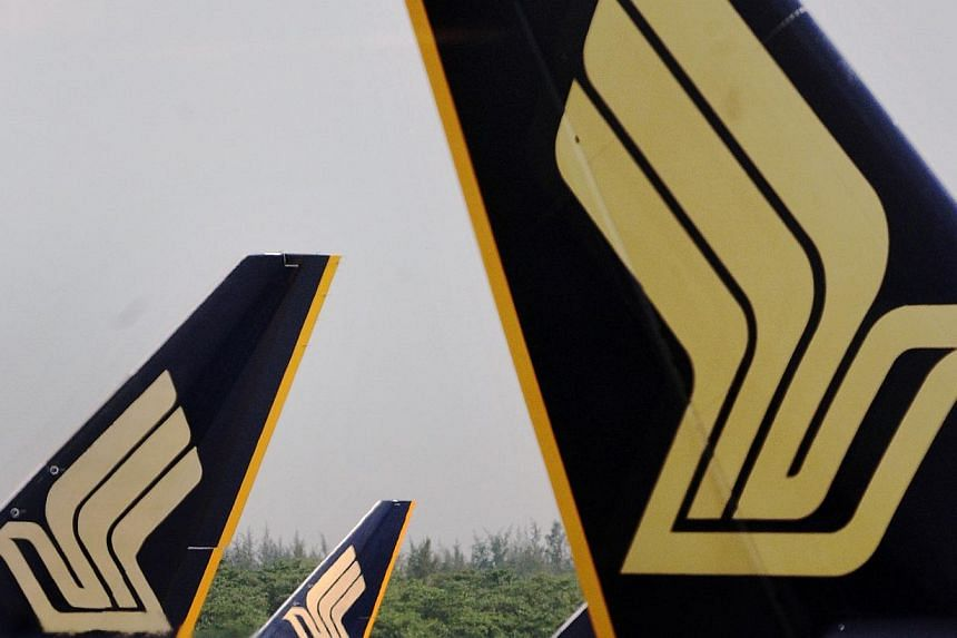 Singapore Airlines (SIA) has apologised to a group of musicians who missed their flight last weekend because ground staff at Hong Kong airport barred them from boarding the plane with their instruments. -- PHOTO: ST FILE
