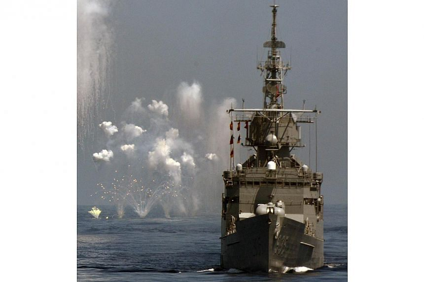 A US-made Perry-class frigate takes part in the Han Kuang drill at sea near eastern Hualien on Sept 17, 2014. Taiwan's Defence Ministry said on Tuesday, Dec 9, 2014, that it plans to buy two Perry-class frigates from the United States, and that it ho