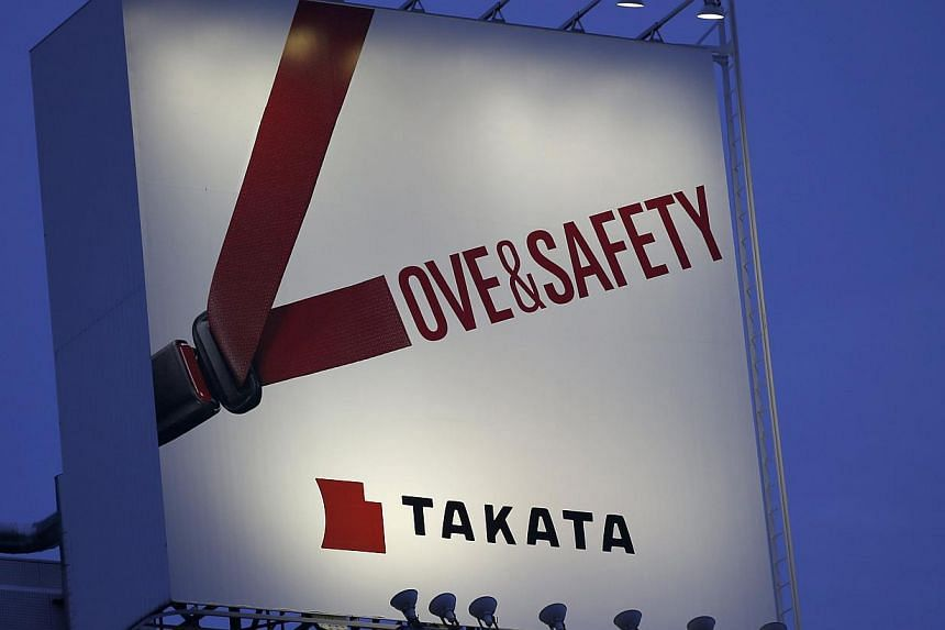 A Tokyo billboard advertisement for Takata Corp in September. -- PHOTO: REUTERS