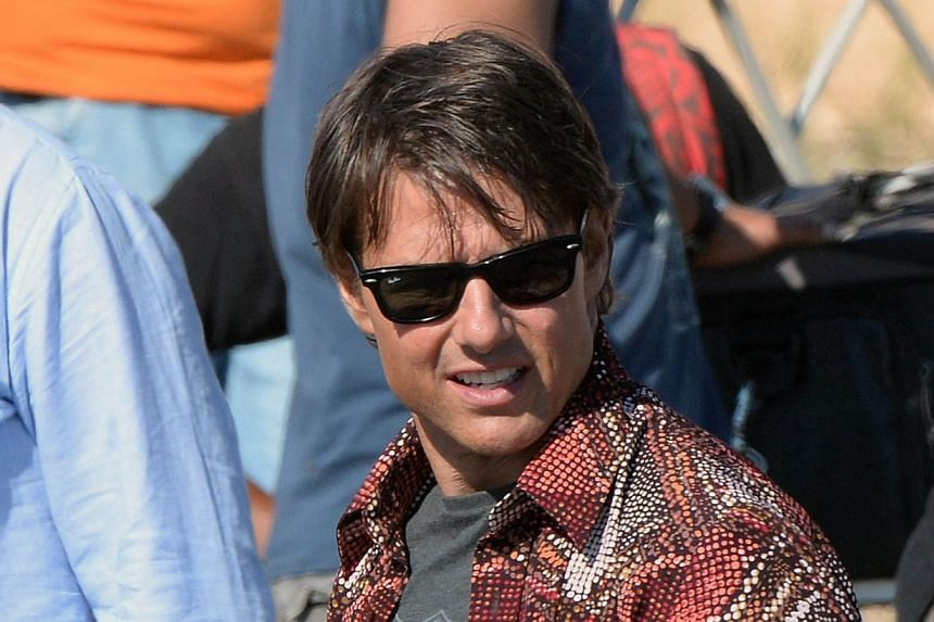 US actor Tom Cruise taking a break from filming for Mission Impossible 5 on Sept 25, 2014, near the Moroccan capital Rabat. hacked documents revealed that he had once been considered to play late Apple boss Steve Jobs. -- PHOTO: AFP