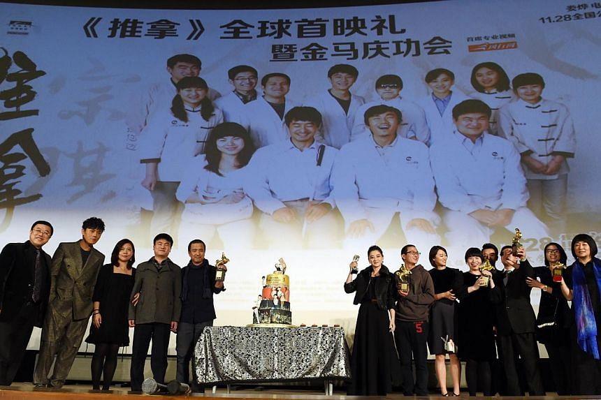 The cast and crew of the award-winning film Blind Massage before its premiere at a cinema in Beijing. The first non-yuan-denominated fund dedicated to investments in China's media entertainment industry, valued at $130 million, was launched yesterday