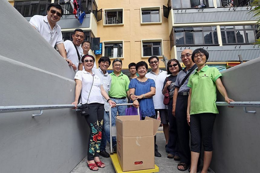 Some of the members of Friends in Charity,a group of about 40 volunteers who distribute food to about 120 low-income families each month. -- ST PHOTO:SEAH KWANG PENG