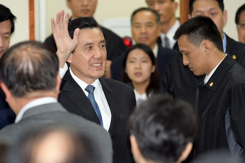Taiwan President Ma Ying-jeou waving to his KMT party colleagues after resigning as chairman on Dec 3, 2014, after the ruling party's massive polls defeat. -- PHOTO: AFP
