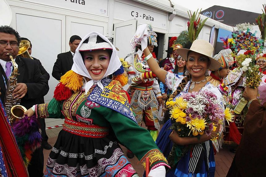 Women dressed in Andean traditional costumes dancing outside the opening of the High-Level Segment of the UN Climate Change Conference COP 20 in Lima, Peru, on Dec 9, 2014. The two-week long United Nations climate summit opened on Dec 1. -- PHOTO: RE