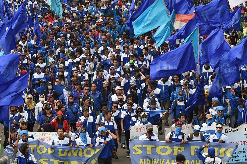 Thousands of workers rallied in the Indonesian capital Jakarta on Dec 10, 2014.. -- PHOTO: AFP