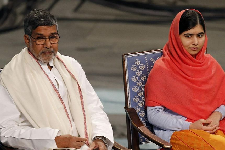 Nobel Peace Prize laureates Malala Yousafzai and Kailash Satyarthi listening to speeches during the Nobel Peace Prize awards ceremony at the City Hall in Oslo on Dec 10, 2014. -- PHOTO: REUTERS