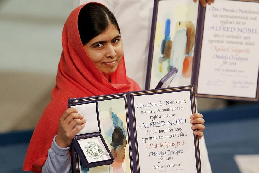 Nobel Peace Prize laureate Malala Yousafzai with the medal and diploma during the Nobel Peace Prize awards ceremony at the City Hall in Oslo on Dec 10, 2014. -- PHOTO: REUTERS