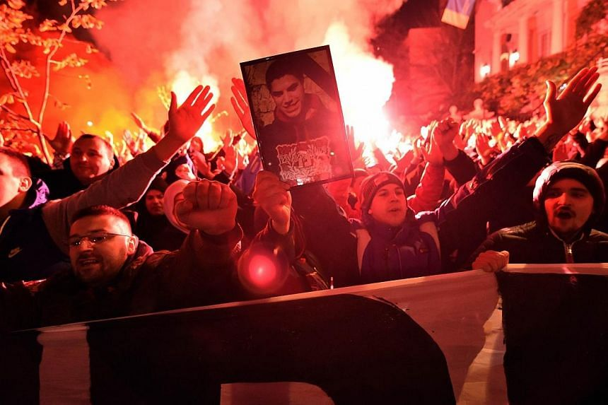 Red Star Belgrade supporters hold a picture of 25-year-old Marko Ivkovic, stabbed to death in Istanbul before an Euroleague match with Galatasaray on Friday, during a protest near the Turkish embassy in Belgrade on Nov 22, 2014. Galatasaray and