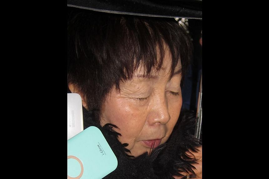 "This picture taken on Mar 13, 2014 shows 67-year-old Japanese woman Chisako Kakehi, who was arrested in Kyoto on Nov 19 on suspicion of poisoning her husband with cyanide in the latest ""Black Widow"" case. She has since been charged on Wednesday"