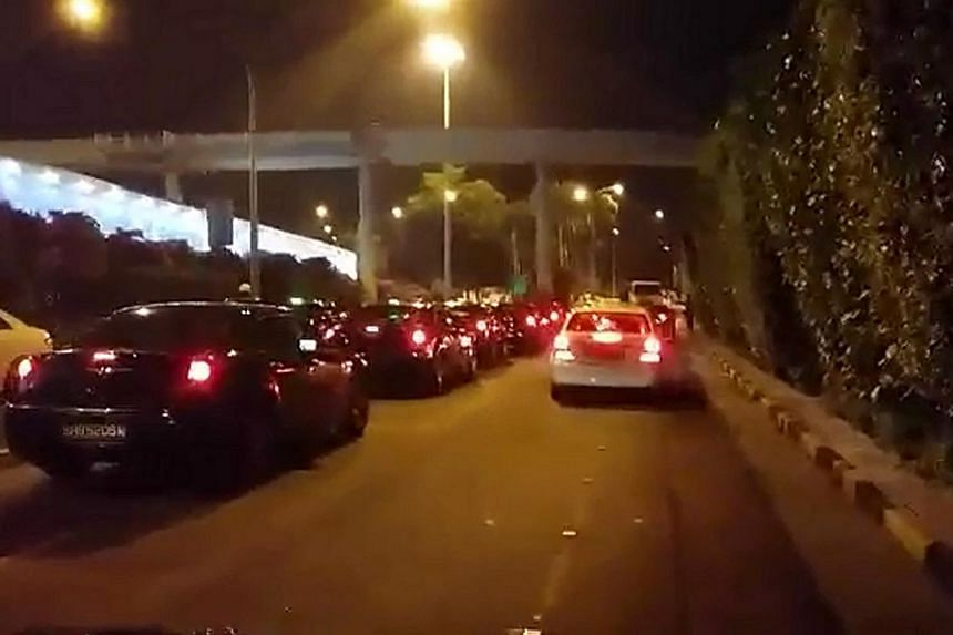 Drivers of premium cabs blared their horns continuously in the early hours of yesterday to show their unhappiness with the new segregated queue system on trial at Changi Airport's Terminal 1. Some said as many as 400 cabs had participated in the prot