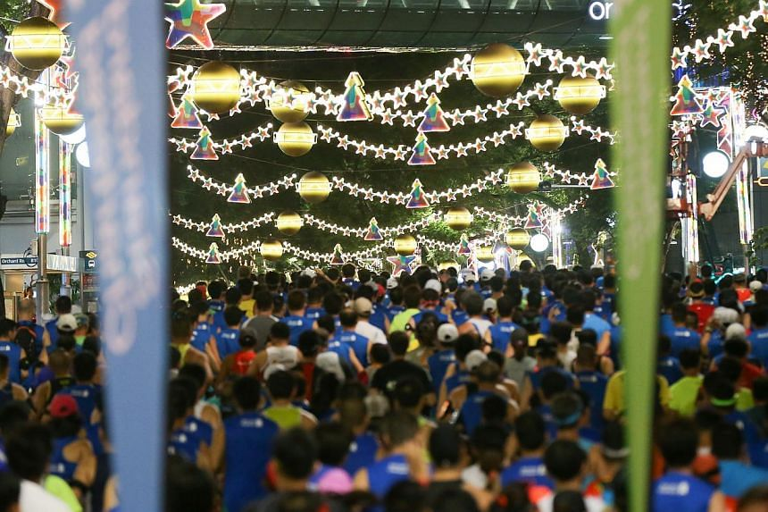 Participants at the flag-off point of the Standard Chartered run in Orchard Road on Sunday.