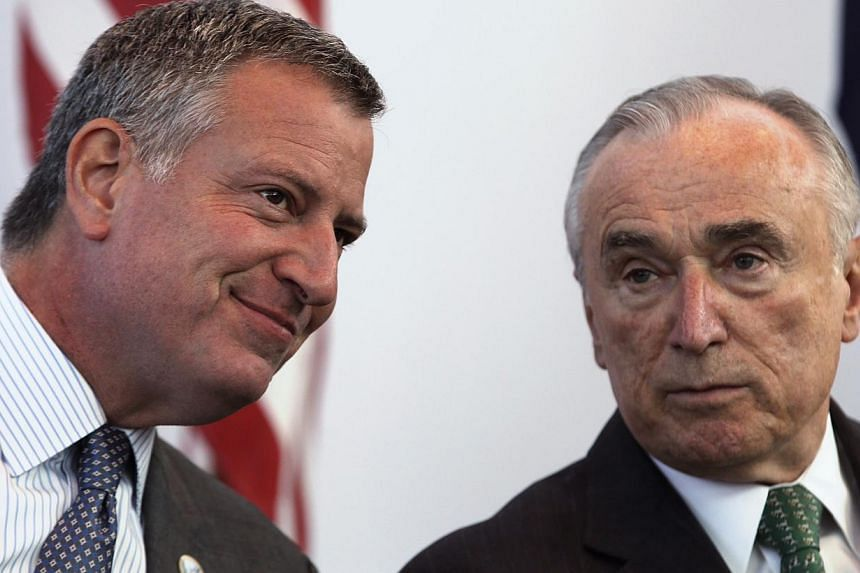 New York City police commissioner William Bratton (right) with New York City Mayor Bill de Blasio (left) ata news conference ahead of the city's marathon in New York, Oct 30, 2014. Brattonvowed on Tuesday to repair relations with po