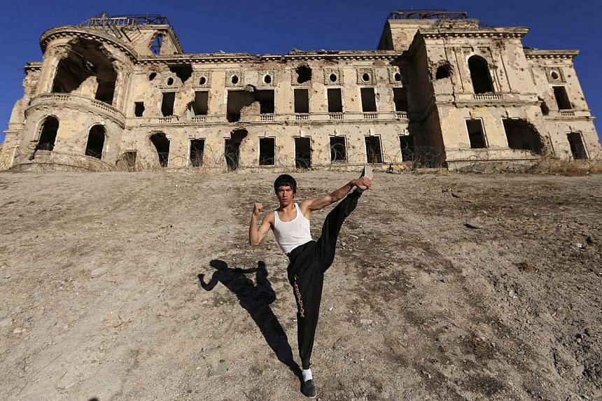 Mr Abbas Alizada in front of the destroyed Darul Aman Palace in Kabul on Dec 9, 2014. -- PHOTO: REUTERS
