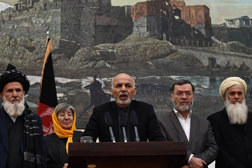 Afghan President, Ashraf Ghani (centre) speaks during a press conference at the Presidential Palace in Kabul on Dec 10, 2014. He condemned the CIA torture detailed in a US Senate report. -- PHOTO: AFP