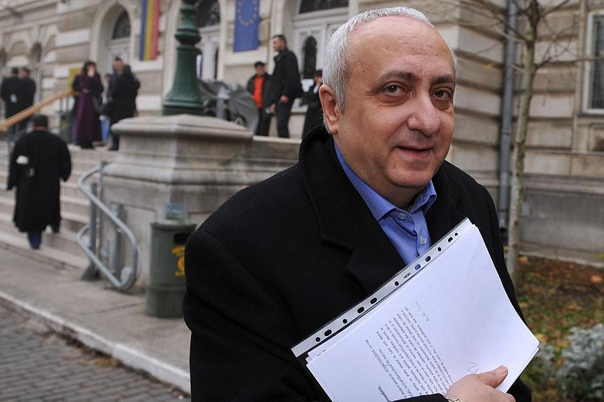A 2011 file photo shows former Romanian diplomat Silviu Ionescu leaving Bucharest's courthouse after a hearing. Ionescu died on Tuesday in a Bucharest jail hospital, local media reported. -- PHOTO: AFP