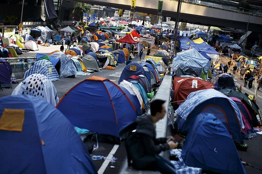 Protesters and tents occupy the main road to the financial Central district in Hong Kong on Dec 9, 2014. -- PHOTO: REUTERS