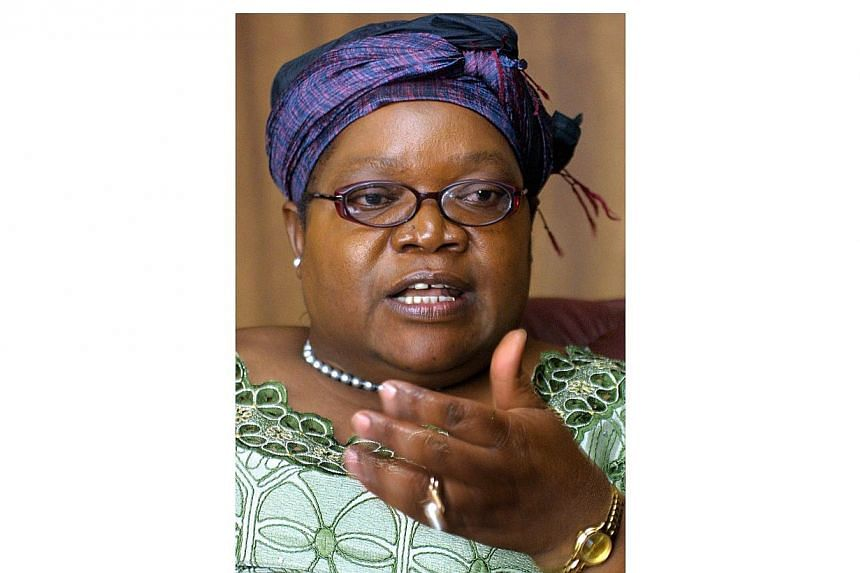 A 2006 photo shows Zimbabwe's vice-president Joice Mujuru in her office at President Robert Mugabe's ruling ZANU-PF party headquaters in Harare. Mujuru, once seen as President Mugabe's heir apparent, has been fired along with eight Cabinet allies. --