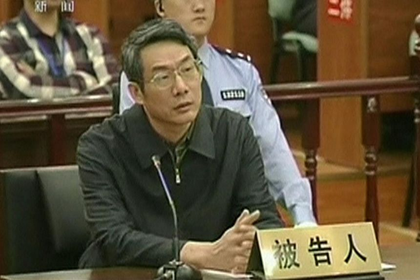Former top economic planning official Liu Tienan during his trial in Langfang, Hebei province on Sept 24, 2014. He was found guilty of bribery on Dec 10 and was sentenced to life in prison. -- PHOTO: REUTERS