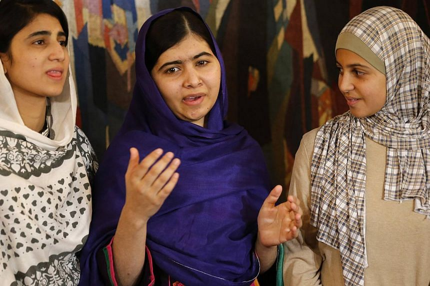 Nobel Peace Prize laureate Malala Yousafzai (centre) being flanked by Sahazia Ramzan (left) of Pakistan and Mezon Almellehan of Syria, young women activists Malala invited to accompany her in Oslo on  Dec 9, 2014. -- PHOTO: REUTERS