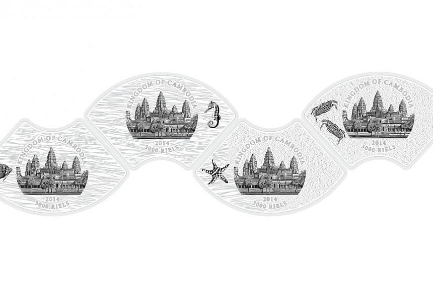 The back of the four marine life-themed coins. When connected, they form the shape of a wave. -- PHOTO:THE SINGAPORE MINT