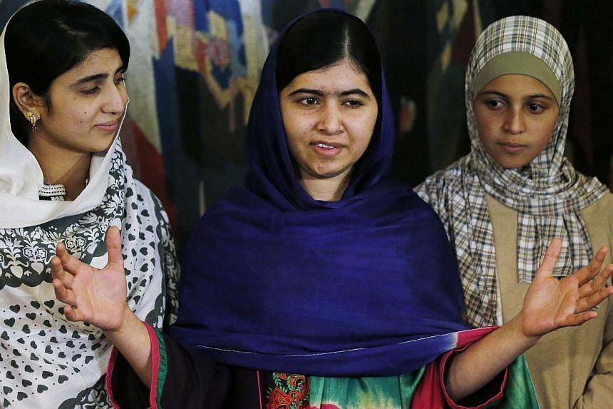 Nobel Peace Prize laureate Malala Yousafzai (centre) with women activists Sahazia Ramzan of Pakistan (left) and Mezon Almellehan of Syria, whom she invited to accompany her to Oslo, Norway, on Dec 9, 2014. -- PHOTO: REUTERS