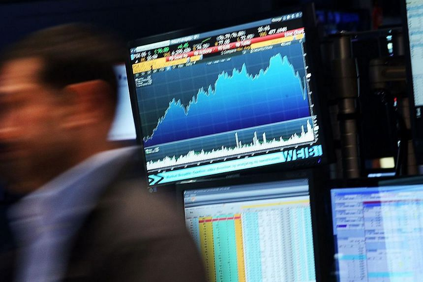 A trader works on the floor of the New York Stock Exchange (NYSE) in New York City on Oct 21, 2014. -- PHOTO: AFP