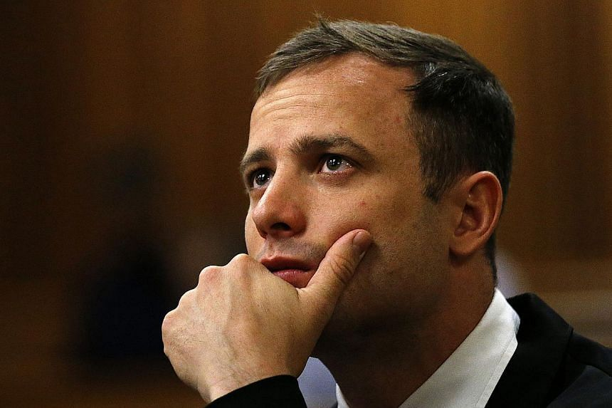 South African paralympic athlete Oscar Pistorius before his sentencing hearing at the North Gauteng High Court in Pretoria on Oct 16, 2014. -- PHOTO: AFP