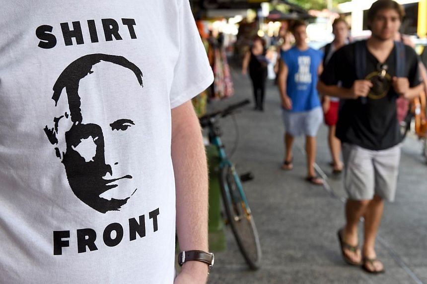 "A t-shirt featuring Russia's President Valdimar Putin and a quote from Australia's Prime Minister Tony Abbott threatening to ""shirt front"" the Russian leader at the G20 Leader's Summit in Brisbane on Nov 13, 2014. ""Shirtfront"" was picked as the Natio"
