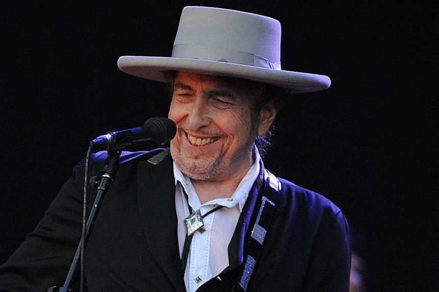 US legend Bob Dylan performs on stage during the 21st edition of the Vieilles Charrues music festival in Carhaix-Plouguer, western France in 2012. Bob Dylan's new album which will come out in February will feature interpretations of classics sung by