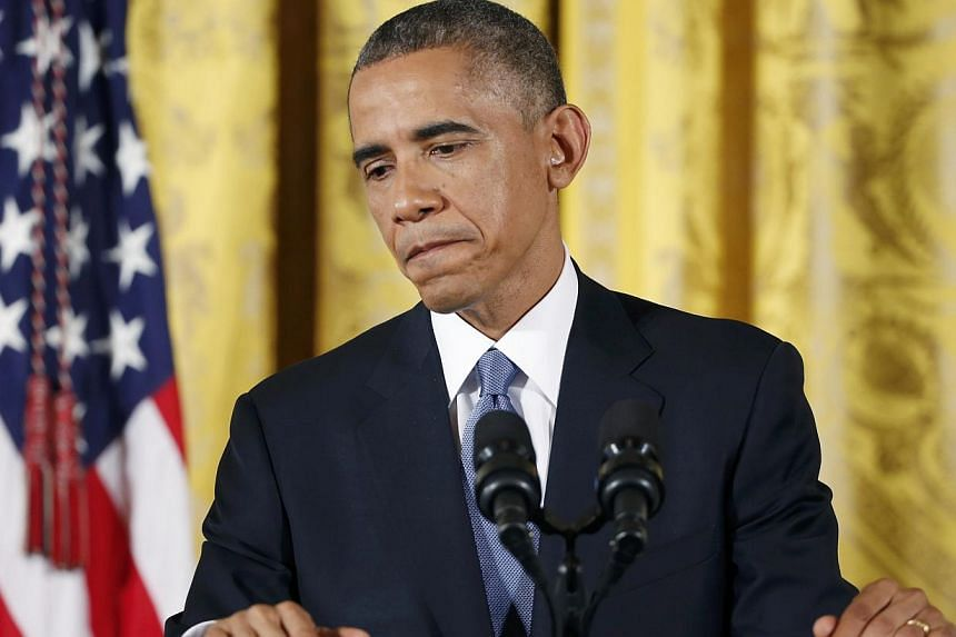 US President Barack Obama answers questions at a recent news conference in the East Room of the White House in Washington. -- PHOTO: REUTERS