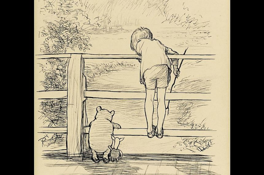 """A handout picture received on December 8, 2014 from Sotheby's London shows E H Shepard's original ink drawing of Winnie-the-Pooh, Christopher Robin and Piglet on the """"Poohsticks"""" bridge. -- PHOTO: AFP"""