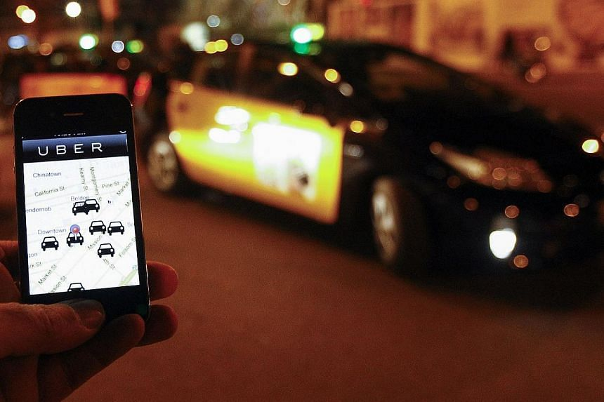 The Uber app is seen on a smartphone. The ride-sharing service and Silicon Valley superstar startup, has hit problems around the world which threaten to put the brakes on its spectacular growth. -- PHOTO: AFP