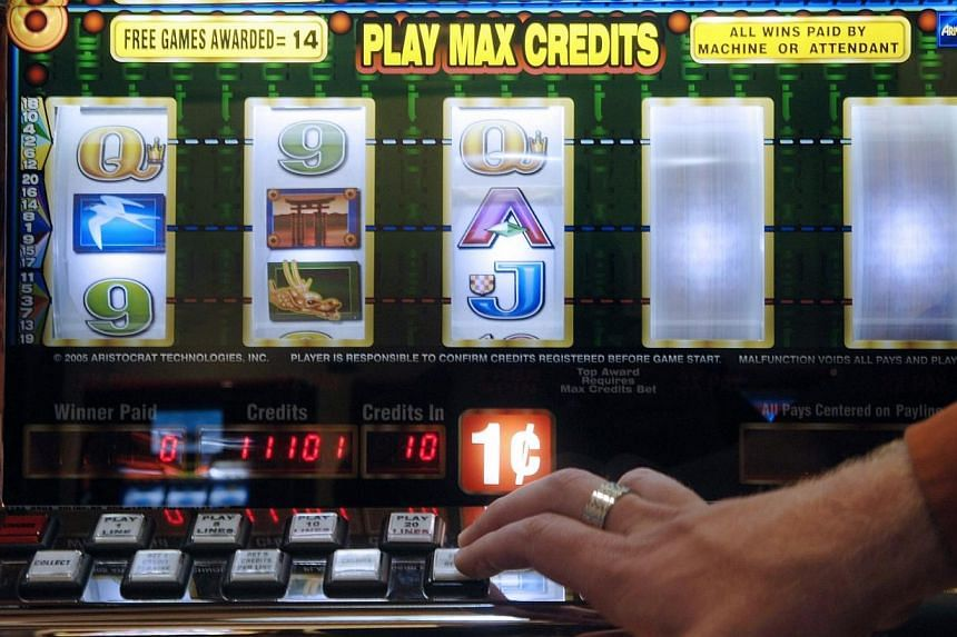 A Vienna gambler will get back almost 440,000 euros (S$718,351) that he squandered on slot machines, after a local court ruled that he suffered from an addiction, his lawyer said Thursday. -- PHOTO: BLOOMBERG