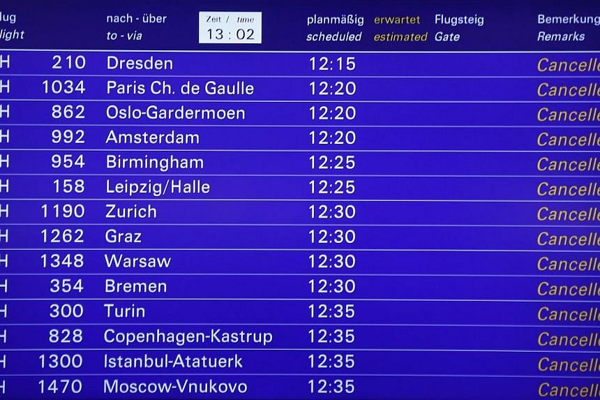 Cancelled flights of German flagship carrier Lufthansa are pictured on an information board in Frankfurt's airport, on Dec 1, 2014.The German government has approved a draft law to limit the power of small labour unions whose strikes have paral