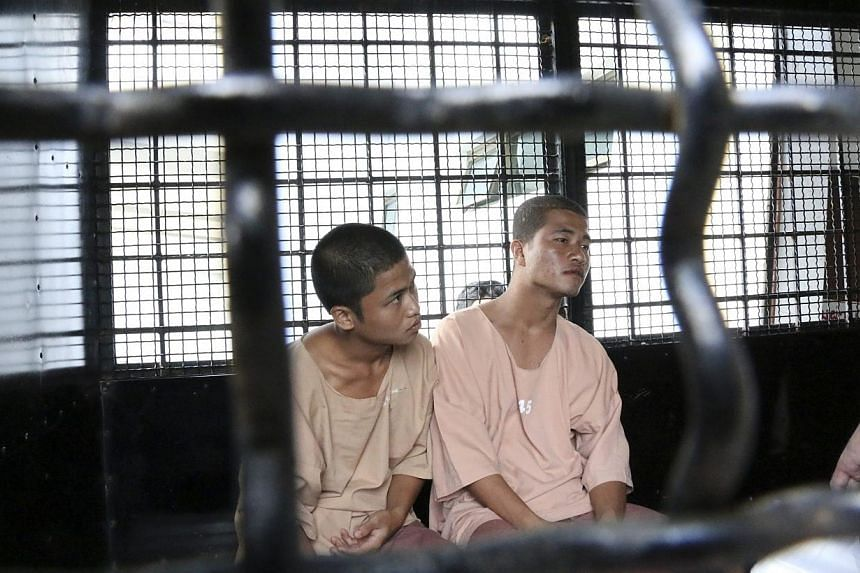 Win Zaw Htun (left) and Zaw Lin, workers from Myanmar accused of killing two British tourists, are brought to a court in Koh Samui on Dec 8, 2014. The two men have written to Nobel Peace laureate Aung San Suu Kyi pleading for help, protesting th