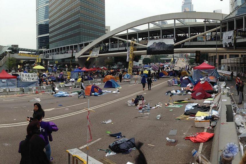 Abandoned tents and equipment left behind by protesters in the Admiralty district of Hong Kong on Dec 11, 2014. A few protesters were seen milling about despite police orders to leave. -- ST PHOTO: CHONG ZI LIANG