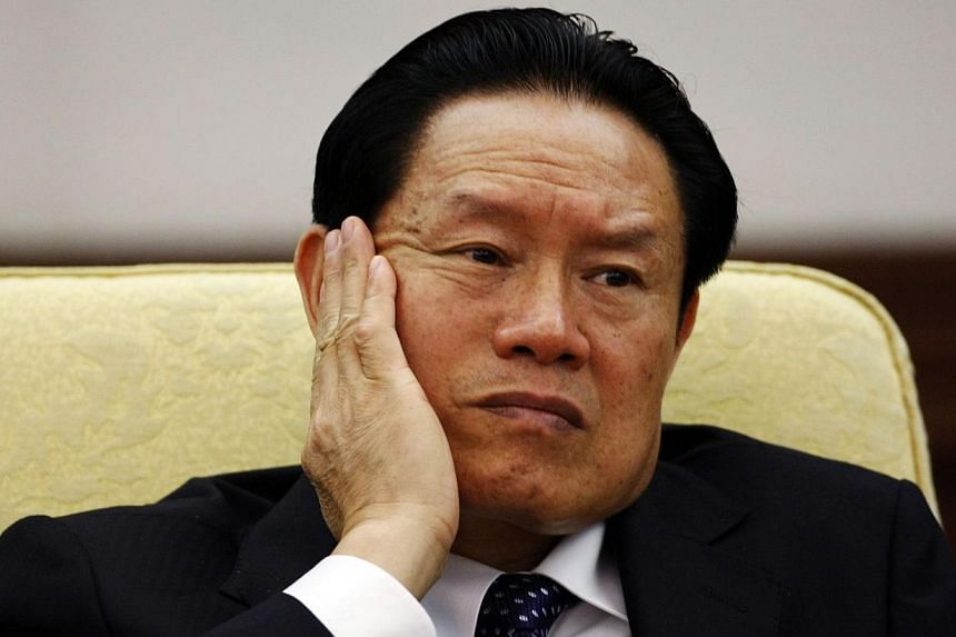 China's former Public Security Minister Zhou Yongkang reacts as he attends the Hebei delegation discussion sessions at the 17th National Congress of the Communist Party of China at the Great Hall of the People, in Beijing in this Oct 16, 2007 file ph
