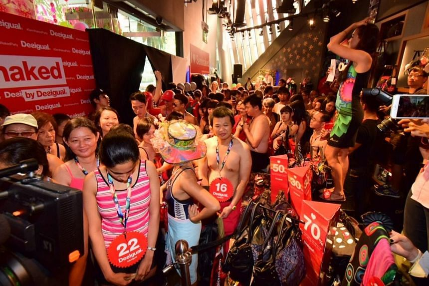 Some 100 people took part in Spanish high-street fashion label Desigual's seminaked campaign on Thursday morning. --PHOTO: LIANHE WANBAO
