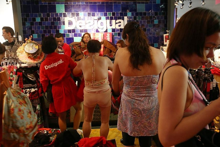 Some 100 people took part in Spanish high-street fashion label Desigual's seminaked campaign on Thursday morning. -- ST PHOTO: SEAH KWANG PENG