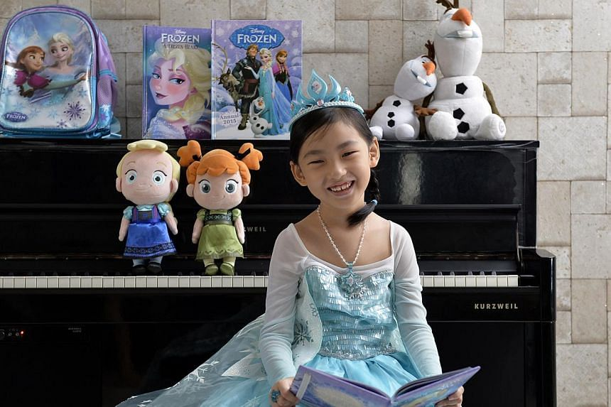 Six-year-old Clare Lim loves the film Frozen and sings the songs from its soundtrack every day. -- ST PHOTO: DESMOND FOO