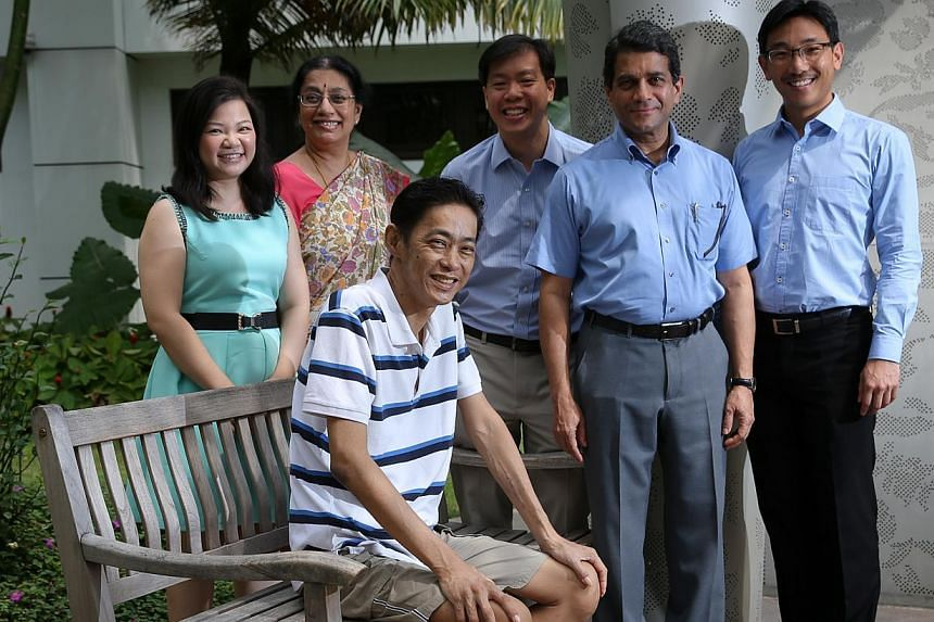 Mr Seow Hock Lin (seated) with the team that performed the combined pancreas and kidney transplant: (from left) transplant coordinator Joreen Poh; NUH National University Centre for Organ Transplantation co-director A. Vathsala; SGH hepato-pancreato-