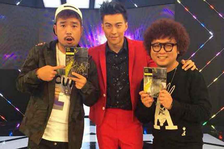 Nat Ho, on Taiwanese entertainment programme Showbiz (above centre), has to keep in shape as his sculpted figure is being marketed as a selling point. -- PHOTO: VELOCE ENTERTAINMENT