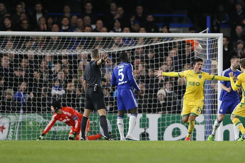 Sporting's Jonathan Silva (third right) celebrates after scoring a goal against Chelsea during their Champions League soccer match at Stamford Bridge in London Dec 10, 2014. -- PHOTO: REUTERS