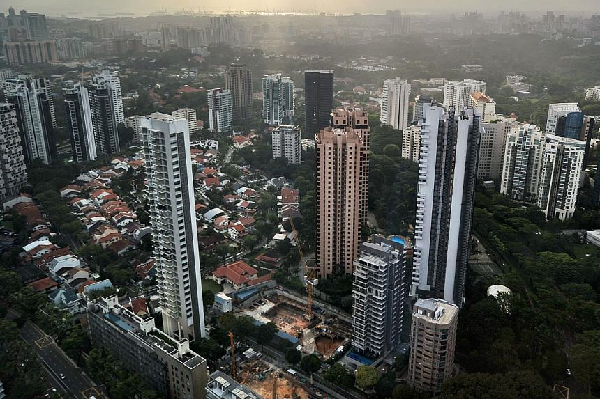 High-rise condominium buildings in the Singapore city centre and outskirts. One in four private home owners will pay less property tax next year after the taxman marked down the annual values of about 73,300 homes. -- ST PHOTO: ALPHONSUS CHERN