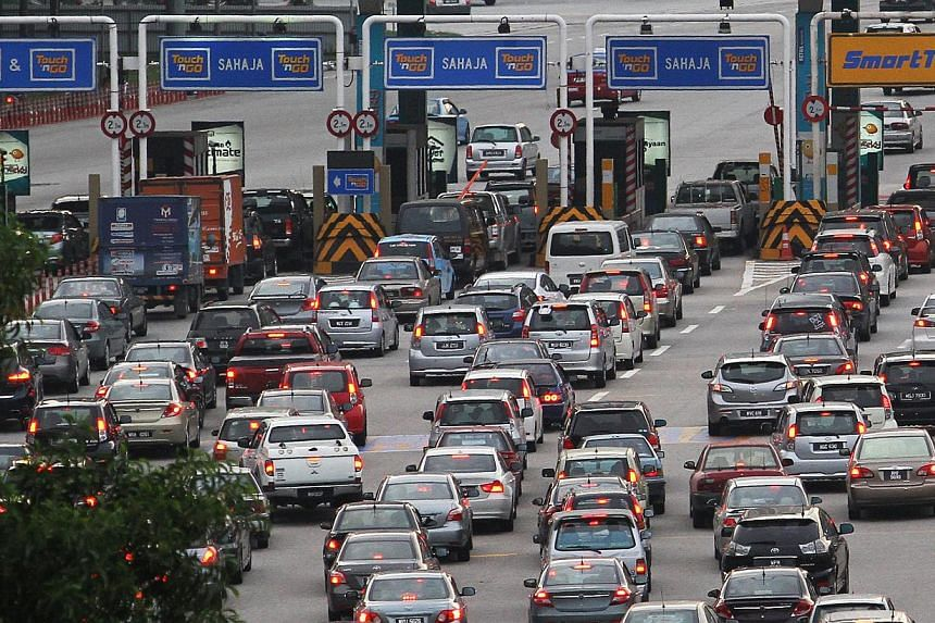 Motorists in Kuala Lumpur. Malaysia is studying a new system to stop foreigners from leaving the country without settling their traffic summons. - THE STAR/ASIA NEWS NETWORK