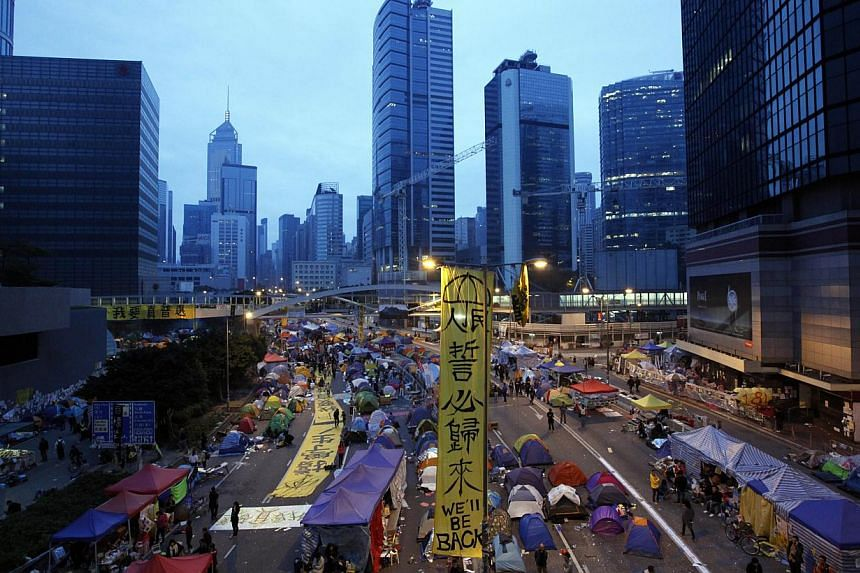 An early morning view of the main pro-democracy protest site in the Admiralty district of Hong Kong on Dec 11, 2014. Court bailiffs, accompanied by police officers, are giving a final warning to protesters to leave, as they prepare to clear out the a