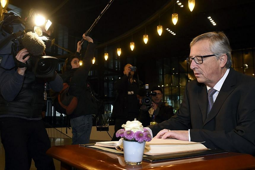 EU Commission president Jean Claude Juncker signs a guest book before his solemn undertaking on Dec 10, 2014 at the Court of Justice of the European Union in Luxembourg. Juncker vowed Wednesday to fight tax avoidance in Europe after new revelations s