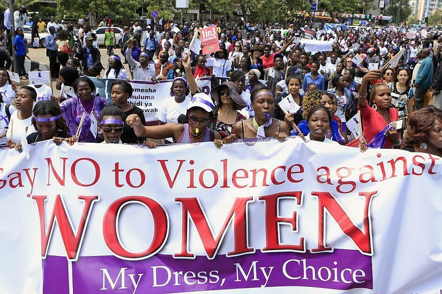 Women take part in a protest along a main street in the Kenyan capital of Nairobi on Nov 17, 2014. Two Kenyans accused of stripping a woman at a petrol station on Sept 19, 2014, have been charged with sexual assault, reports said on Thursday, De